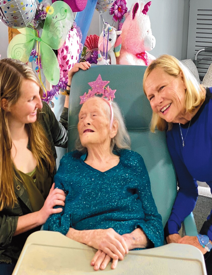Ruth Christensen celebrates her 100th birthday in 2020 with her daughter Lea (right) and granddaughter Rianna.