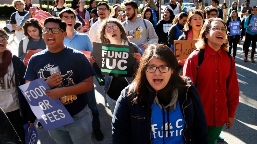 University of California students protest proposed tuition hikes outside a regents meeting, Thursday
