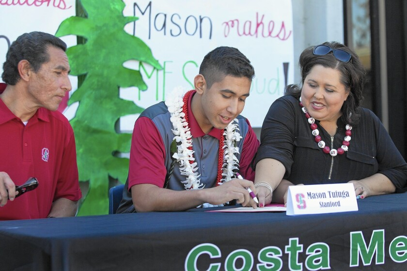 Costa Mesa High volleyball standout Mason Tufuga, center, signs his letter of intent to play for Stanford University.
