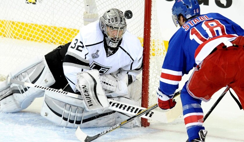 Kings goaltender Jonathan Quick deflects a shot by Rangers defenseman Marc Staal into the air in the first period of Game 4 on Wednesday night in New York.