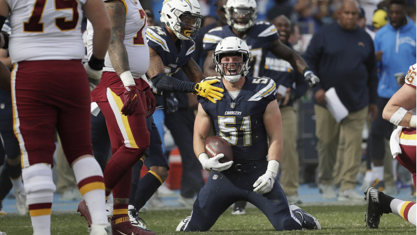 Chargers linebacker Kyle Emmanuel celebrates after intercepting a pass by Redskins quarterback Kirk Cousins during the first quarter.
