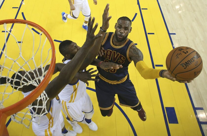 Cleveland Cavaliers forward LeBron James, right, shoots against the Golden State Warriors during the second half of Game 2 of basketball's NBA Finals in Oakland, Calif., Thursday, June 2, 2016. The Warriors won 104-89. (Ezra Shaw, Getty Images via AP, Pool)