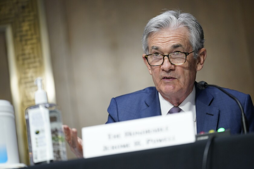 FILE - In this Dec. 1, 2020, file photo, Chairman of the Federal Reserve Jerome Powell speaks during a Senate Banking Committee hearing on Capitol Hill in Washington. The U.S. economy has been showing unexpected strength in recent weeks, with barometers of hiring, spending and manufacturing all surging. (AP Photo/Susan Walsh, Pool)