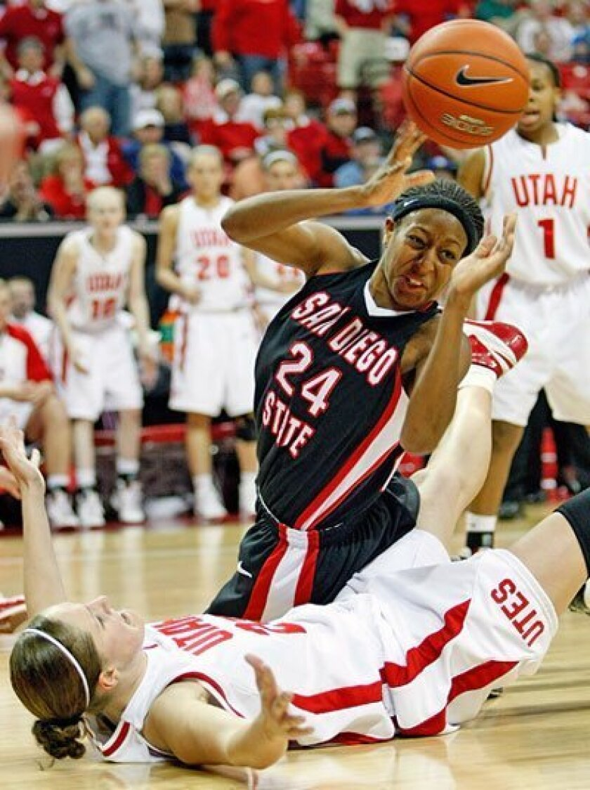 Aztecs senior forward Jennifer Layton-Bailes is fouled after she tangles with Deanne Stevenson and crashes to the court. (Getty Images)