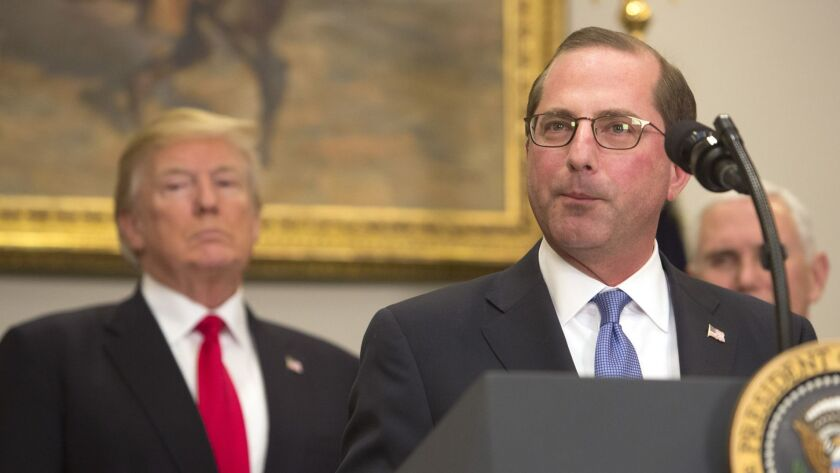 Alex Azar speaks after his swearing in as secretary of Health and Human Services in January, as President Trump looks on.