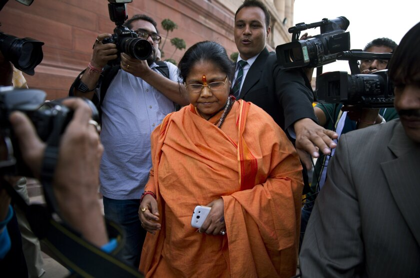 Junior minister Sadhvi Niranjan Jyoti is chased by the press as she walks out of the Indian parliament in New Delhi on Dec. 5. Prime Minister Narendra Modi rejected calls to fire her over derogatory comments she made about Muslims.