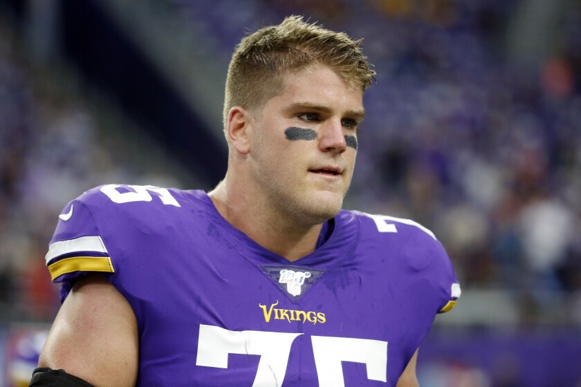 FILE - In this Sept. 8, 2019, file photo, Minnesota Vikings offensive tackle Brian O'Neill walks on the field before an NFL football game against the Atlanta Falcons in Minneapolis. The Vikings have signed O'Neill to a contract extension. (AP Photo/Bruce Kluckhohn, File)