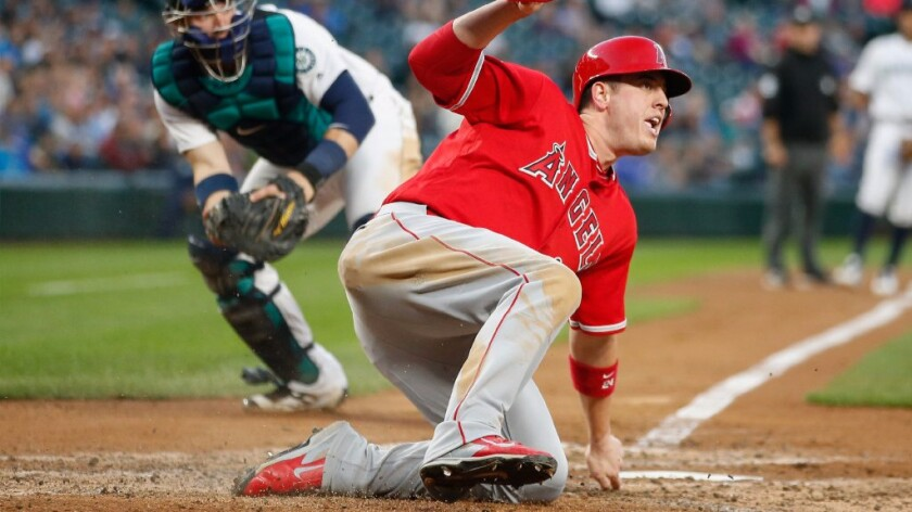 Angels hit three consecutive home runs en rout to 10-3 win over Mariners