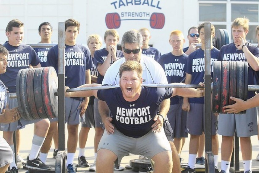 Newport Harbor High junior Ramsey Hufford attempts to squat 533 pounds during the school's annual lift-a-thon on Friday. Hufford completed a squat of 506 pounds prior to this weight attempt.