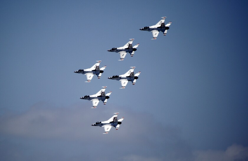 The Air Force Thunderbirds do a fly-by to salute the state's COVID-19 first responders, some of whom watched from Hoag Memorial Hospital Presbyterian in Newport Beach on Friday.