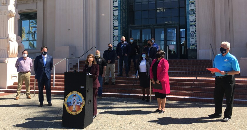Standing outside the San Diego County Administration Center, District Attorney Summer Stephan announced the new unit.