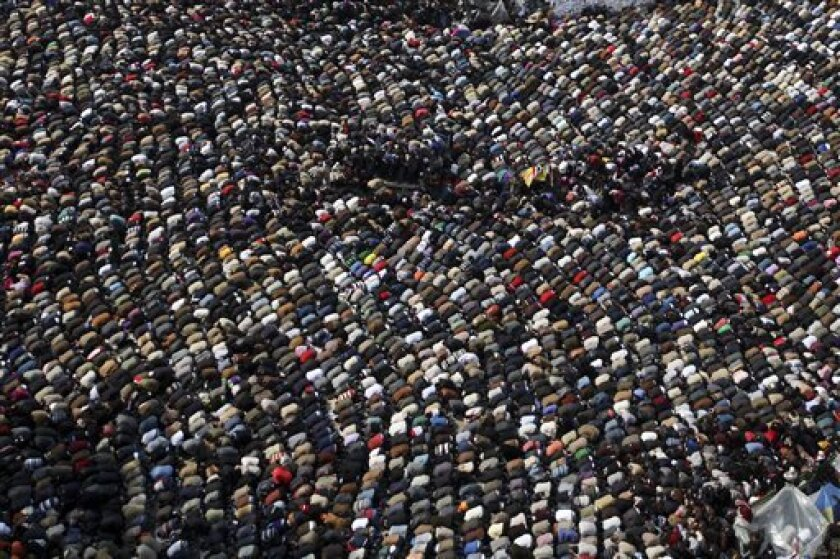 Anti-government protesters make traditional Muslim Friday prayers at the continuing demonstration in Tahrir Square in downtown Cairo, Egypt Friday, Feb. 11, 2011. (AP Photo/Tara Todras-Whitehill)