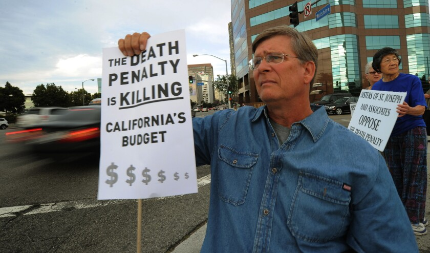 Alan Toy joins an anti-death penalty protest outside the federal building in downtown Los Angeles in 2010.