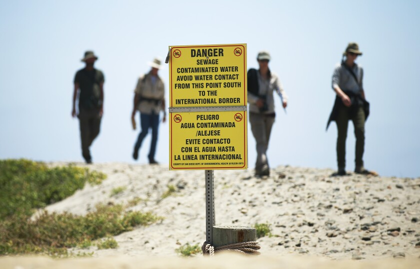 Signs warn of contaminated ocean water in Imperial Beach on May 30, 2019. Recent rains have contaminated the water in the region near the mouth of the Tijuana River.