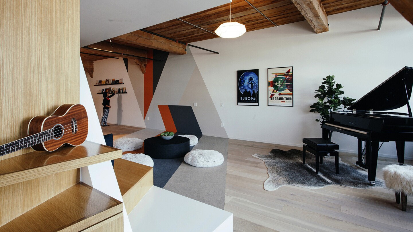 """Wall and floor designs were inspired by the video game """"Monument Valley."""" The furniture was custom-built."""