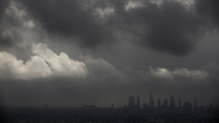 Low clouds drift over the Los Angeles Basin and downtown as light rain and cooler temperatures prevail on Oct. 18.