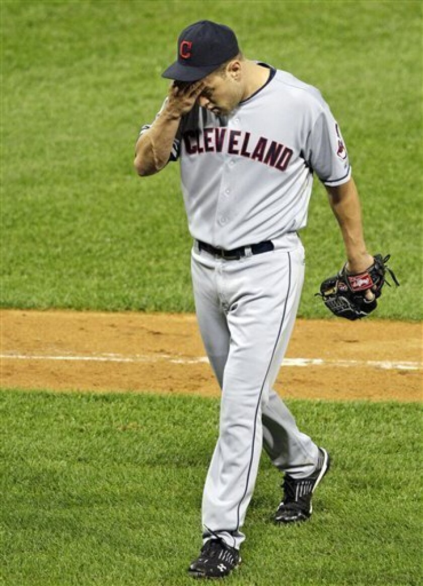 Cleveland Indians relief pitcher Frank Hermann walks back to the dugout after being pulled during the seventh inning of a baseball game against the Chicago White Sox on Thursday, Sept. 8, 2011, in Chicago. (AP Photo/Nam Y. Huh)