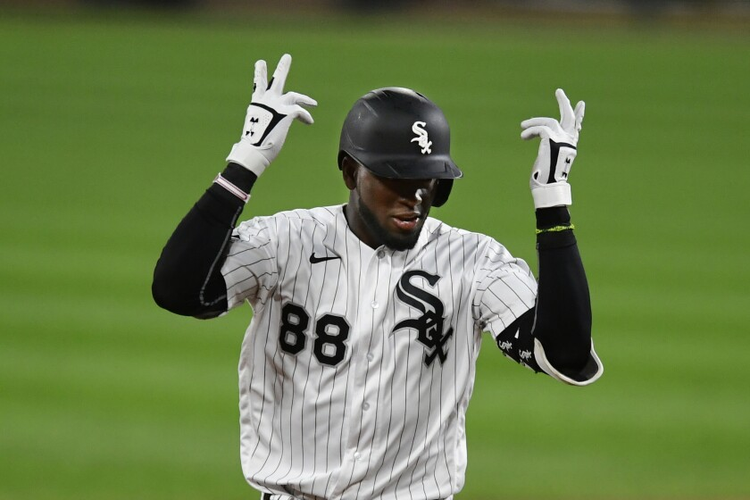 Chicago White Sox's Luis Robert celebrates while rounding the bases after hitting a two-run home run during the eighth inning of a baseball game against the Detroit Tigers Monday, Aug. 17, 2020, in Chicago. (AP Photo/Paul Beaty)