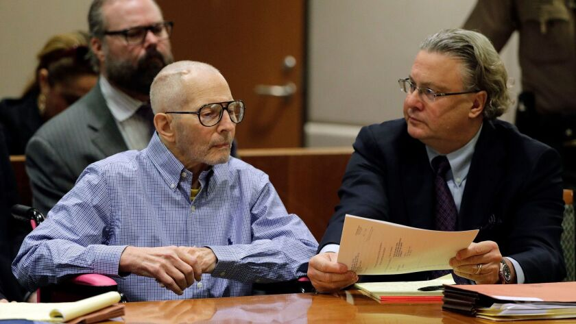 Criminal defense attorney David Chesnoff, right, confers with his client, New York real estate scion Robert Durst. As Durst's murder case moves toward trial, tension has escalated between members of his defense team and the prosecution.