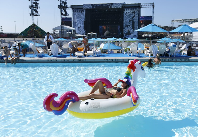 Shannon Thomas floats in the Bask Swim Club as Andrew McMahon plays on the Sunset Cliff Stage at KAABOO Del Mar on Friday