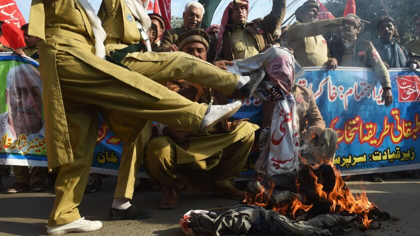 Pakistani demonstrators burn an effigy of President Trump during an anti-US protest in Lahore on Jan. 10.