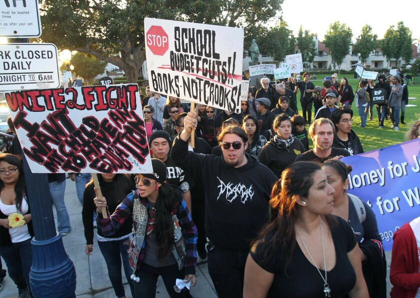 Protesters march down G Street in downtown San Diego Thursday.
