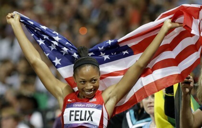United States' Allyson Felix celebrates her win in the women's 200-meter final during the athletics in the Olympic Stadium at the 2012 Summer Olympics, London, Wednesday, Aug. 8, 2012. (AP Photo/Lee Jin-man)