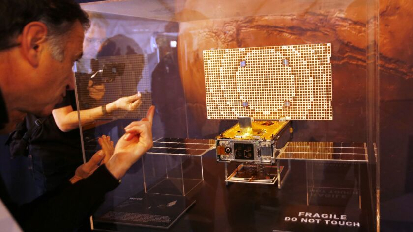 A display of the CubeSat that NASA launched with the stationary lander called InSight too Mars. Riding along with InSight were two CubeSats - the first of this kind of spacecraft to fly to deep space.