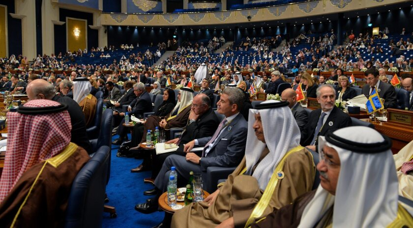 Delegates attend the opening session of the Second International Humanitarian Pledging Conference for Syria in Kuwait City, Kuwait.