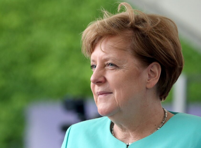 German Chancellor Angela Merkel waits for the arrival of the President of Portugal, Marcelo Rebelo de Sousa, at the chancellery in Berlin, Germany, Monday, May 30, 2016. (AP Photo/Michael Sohn)