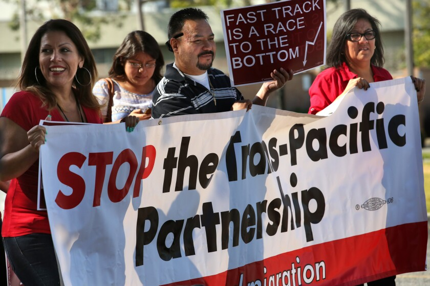 Workers from the AT&T call center and others rally against the proposed Trans-Pacific Partnership trade pact in City of Commerce.