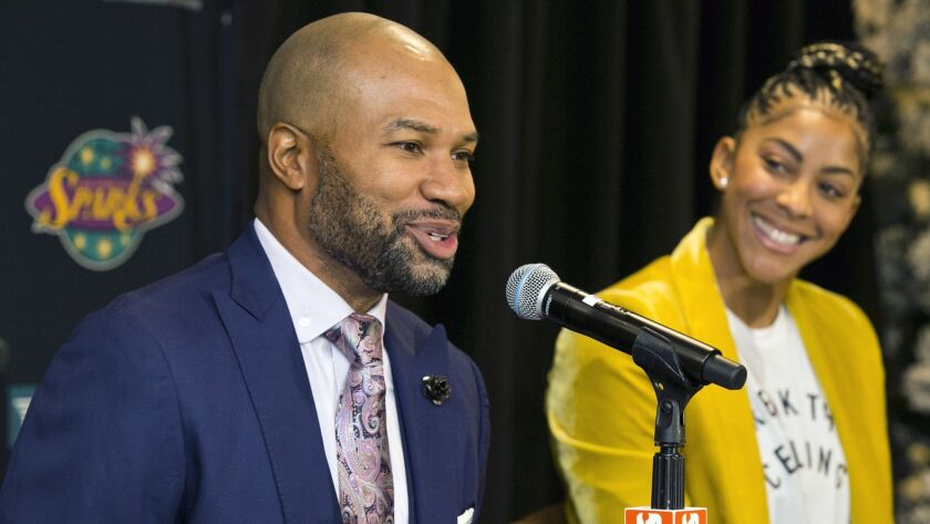 Derek Fisher, the Sparks' new head coach, is joined by two-time WNBA most valuable player Candace Parker during a news conference.