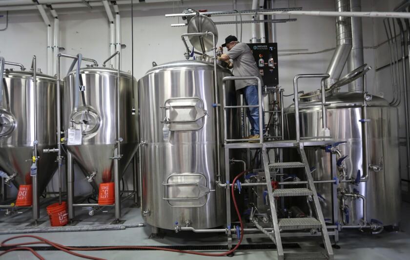 Oct. 5, 2017. San Marcos, CA. USA. |Wild Barrel Brewing Dir. of Brewing Operations Bill Sobieski stirs the brew . |Photos by Jamie Scott Lytle. Copyright.
