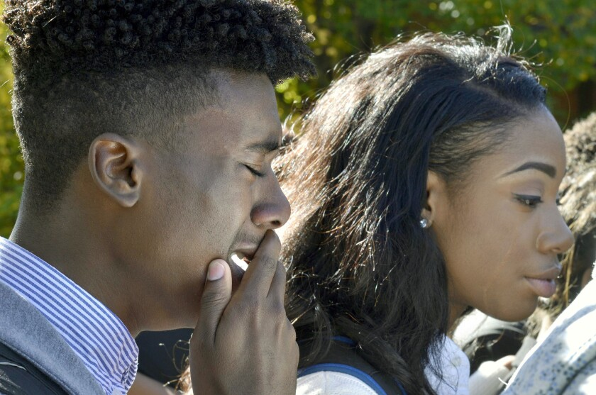 Members of the University of Missouri's Legion of Black Collegians and the Concerned Student 1950 supporters react after an on-campus protest, in Columbia, Mo. on Saturday.