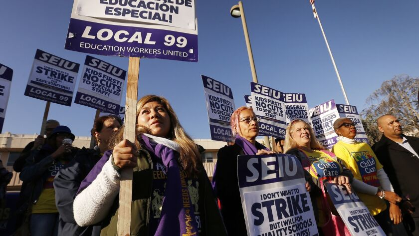 """LAUSD workers march at Marlton School in Baldwin Hills on February 26, to announce strike plans to protest alleged """"unfair practices'' by the Los Angeles school district."""