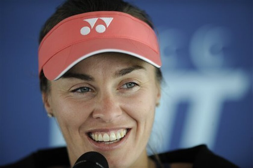 IFLE - In this July 12, 2012 file photo,  Martina Hingis, of Switzerland, speaks during a news conference before World TeamTennis action against the Washington Kastles in Washington. Five-time Grand Slam singles champion Hingis heads the 2013 class for the International Tennis Hall of Fame. The oth