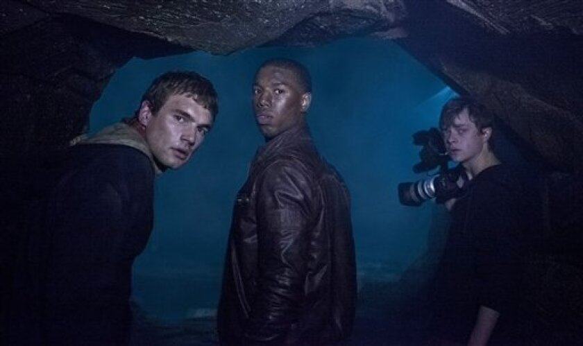 """In this film image released by 20th Century Fox, from left, Alex Russell, Michael B. Jordan, and Dane DeHaan are shown in a scene from """"Chronicle."""" (AP Photo/20th Century Fox, Alan Markfield)"""