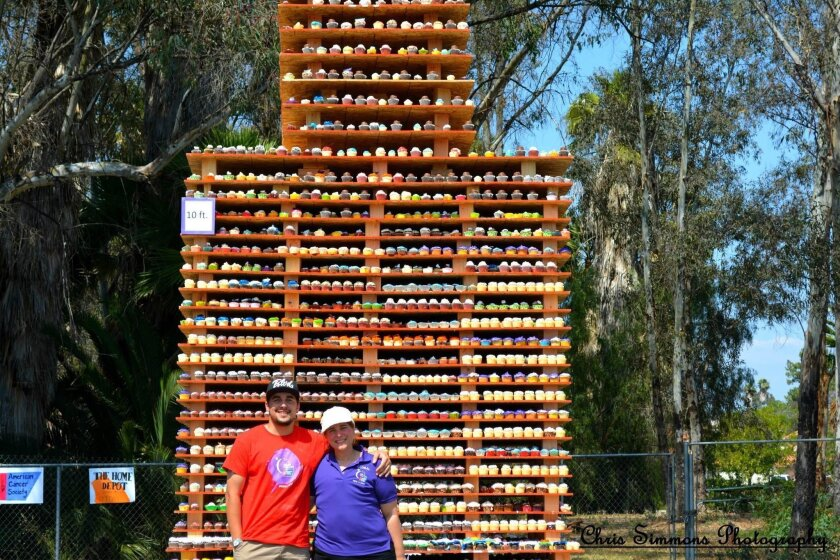 Zoe Richardson Sanchez with her son Chris Simmons in front of the cupcake tower.