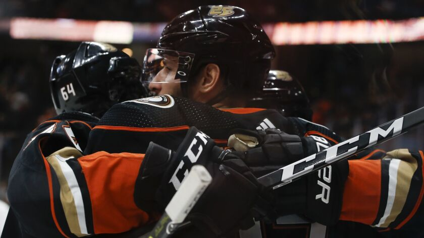Ducks center Ryan Kesler, center, celebrates scoring a goal against the New York Islanders with right wing Kiefer Sherwood, left, during the second period.