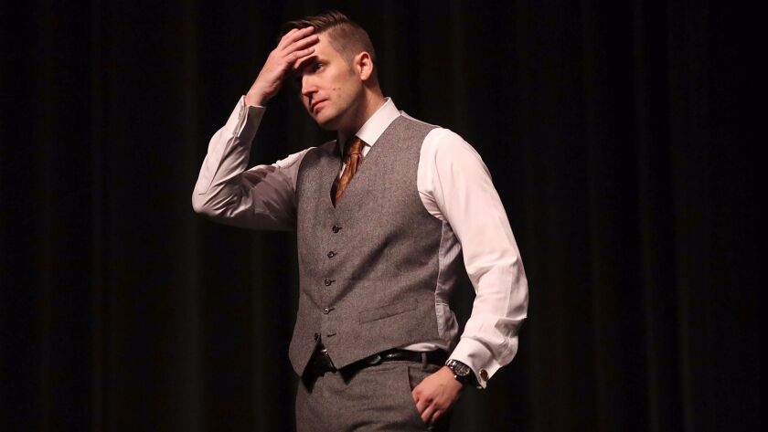 White nationalist Richard Spencer speaks at the University of Florida in 2017. His wife has accused him of physically abusing her throughout their eight-year marriage.