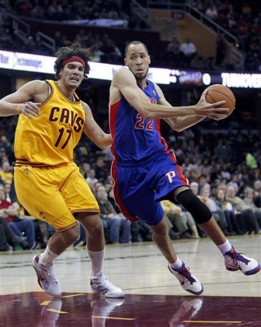 Detroit Pistons' Tayshaun Prince (22) drives past Cleveland Cavaliers' Anderson Varejao (17), from Brazil, during the first quarter of an NBA basketball game Saturday, Dec. 8, 2012, in Cleveland. (AP Photo/Tony Dejak)