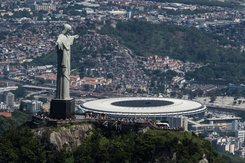 The Christ the Redeemer statue stands above the Maracana stadium in Rio de Janeiro.