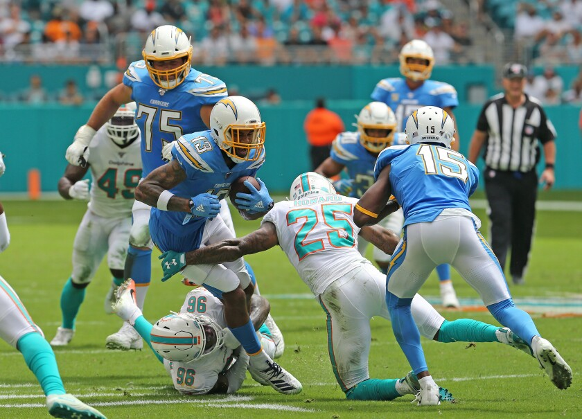 Chargers wide receiver Keenan Allen is tackled against the Dolphins.