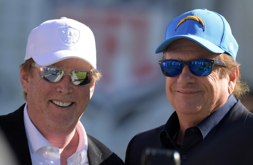 Oakland Raiders owner Mark Davis (left) and Chargers chairman Dean Spanos pose before their teams met last month at Qualcomm Stadium.