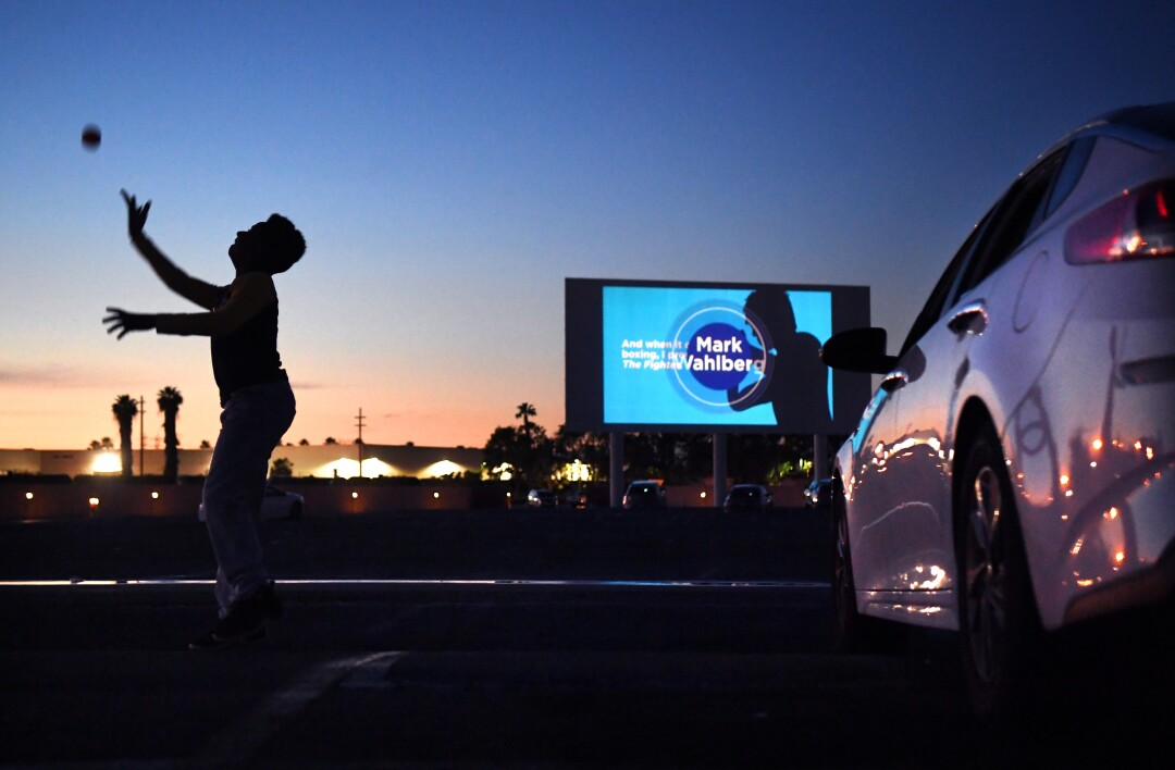 Michael Ray, 11, plays with a ball before a movie at the Paramount Drive-In.