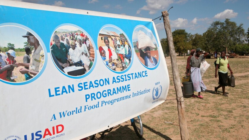 A banner alerts villagers to aid efforts in Mwenezi, Zimbabwe, in June 2016.