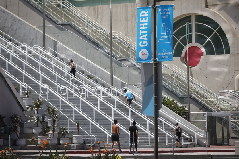 People run the steps at the San Diego Convention Center which has had many of its booked conventions canceled due to the coronavirus pandemic, shown here on April 28, 2020.
