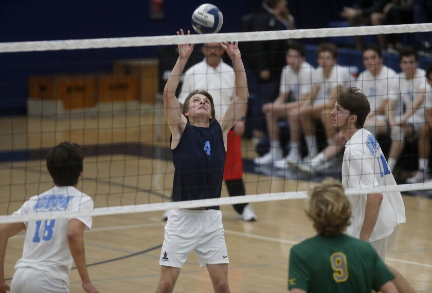 Corona del Mar High's Connor Zylstra (4) sets the ball against Manhattan Beach Mira Costa during the
