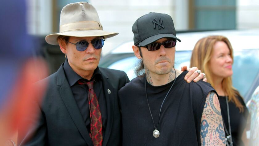 Actor Johnny Depp, left, joins former Arkansas death row inmate Damien Echols at a rally against exe