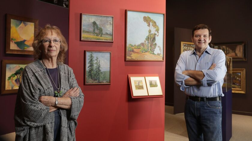 Conservator Maurine St. Guadens and researcher Joseph Morsman stand alongside works by Nelbert Chouinard, founder of the Chouinard Art Institute.